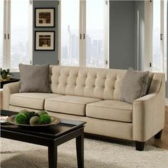 Love the classic style of this sofa. I really want it, but we live in our living room. I can see the stains now!