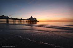 Sunrise over #Eastbourne #Pier, East Sussex, UK. Taken by Mark Huntley www.markhuntley.co.uk