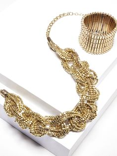 Statement braided necklace and stretch armor bracelet - loving the gold bling from sole society