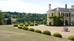 An exterior shot of the magnificient Polesden Lacey, with views of the Surrey Hills in the background © Chris Murphy