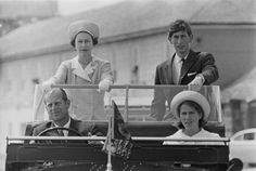 Queen Elizabeth with Prince Charles, Prince Philip, Duke of Edinburgh, and Anne, Princess Royal during a visit to the Isles of Scilly, riding in a Land Rover Defender (1967)