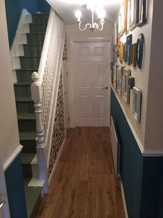 Orla kiely wallpaper painted staircase charity shop frames painted dado rail hall teal sage mustard wooden floor