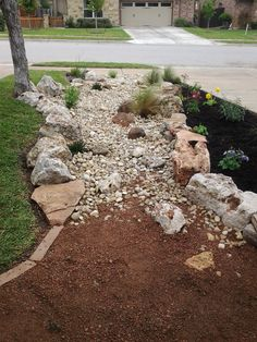 Front yard landscape - dry creek bed using really cool limestone boulders and accent moss boulders. Decomposed granite in the back for a landing pad for the gates to both houses. This is a great use of space that doesn't drain well. Used the decomposed granite for function but gave it a washed out look for a more natural feel and look.