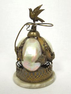 What a dynamite piece.  Antique Victorian Brass & Mother Of Pearl Table Bell by VintageALaMode, on Etsy.