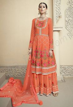 Impressive Orange embroidered sharara suit online which is crafted from Pure Viscose fabric with exclusive embroidery, zari and Hand work. This stunning designer sharara suit comes with georgette bottom and Net dupatta. Sharara Suit, Salwar Kameez, Kurti, Anarkali Suits, Wedding Salwar Suits, Eid Outfits, Indian Outfits, Lehenga Choli, Pakistani Sharara