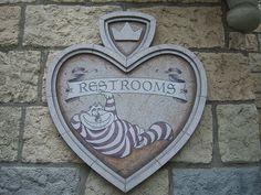 Sign for the Alice in Wonderland bathrooms in Disneyland's Fantasyland