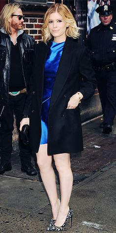 Kate Mara arrived at the Late Show with David Letterman in a satin electric-blue Roland Mouret dress paired with a dark coat, a black clutch, and printed Bionda Castana pumps.
