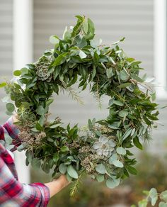 Get the tutorial for this beautiful DIY Christmas wreath made of eucalyptus, cedar and pine along with 100s of Christmas ideas at The Sweetest Occasion!