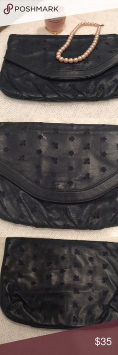 Vintage Navy Blue Eyelet Theodor Clutch Cuteness! Just been sitting in my closet. This is in great vintage condition except for zipper on pocket has paint chipped off, and scuff marks on gold decor and around mirror discoloration. My home is smoke free I do have pets. PLEASE NO OFFERS BELOW 50% OFF ASKING PRICE. 🚫NO TRADES🚫 I am unsure of material no tag stating that information. Thanks for taking a look at my closet 😀😊. Vintage Bags Clutches & Wristlets
