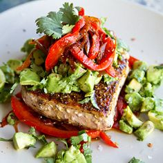 Mexican spiced tuna steak with roasted red peppers and zesty avocado salsa.