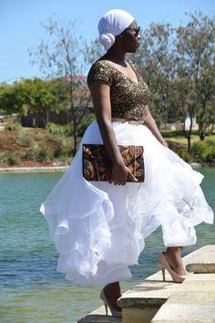 Ruffles skirt with nude pumps and ankara envelope handbag.