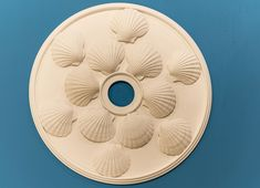is a decorative plaster ceiling medallion that has a coastal theme. It contains Scallop shells on its surface and blends into any room with coastal or beach themed décor. It has a diameter and fits a canopy up to Coastal Living, Coastal Decor, Decorative Plaster, Scallop Shells, Ceiling Medallions, Chandelier Pendant Lights, Shop Lighting, Beach Themes, Ornaments