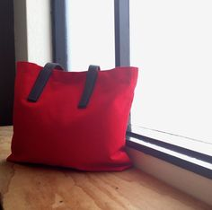 The red tote makes its return today.