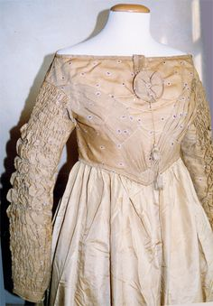 1837 is when the gigot sleeves started to collapse.  It's possible these sleeves and the waistline were altered as the styles changes.  Follow link for another image.