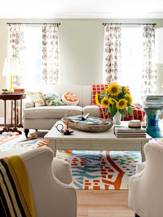 Cheap and Cheerful The owner of this Maine home splashed colorful vintage pieces as well as bold and boisterous pillows—pink bunnies, green squirrels, orange flowers—to add color to her living room. The handwoven rug is by area artisan Angela Adams.