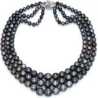 THE NINA DYER BLACK PEARL NECKLACE: A SUPERB THREE-STRAND BLACK PEARL NECKLACE. Of two strands of forty-nine and one fifty-three graduated black pearls to the pear-shaped diamond twin-stone clasp with six-stone diamond detail. Provenance: Nina Dyer, wife of Baron Heinrich Thyssen and later of Prince Sadruddin Aga Khan.