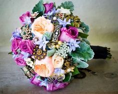 vintage brooch bouquet with silk flowers...novel, clever, colorful, unique & it won't die! Definitely me.