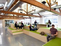 We like the terraces seating and also the color scheme and mood of this setup.   The Airbnb office in London by Threefold
