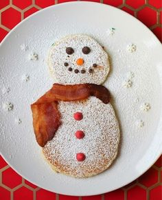 Snowman Pancakes- fun food like this always makes my kids smile.... And it only takes a minute longer to do.