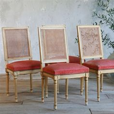 Antique cane back dining chairs with salmon velvet upholstered seating