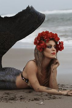 A quick note, most mermaids are at least eco-aware, especially regarding marine life. That said, black tail and red flower crown make a pretty combo. I'm surprised at how well the blonde works with this, but she looks awesome.