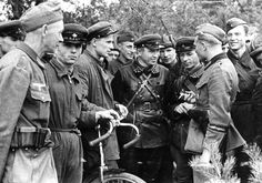 """""""Soviet and German soldiers meet in Brześć Litewski. Looks like one of the Russian soldiers """"managed"""" to """"obtain"""" (steal) bicycle"""" After their their joint invasion of Poland Poland - Brześć Litewski, 22 September, 1939"""
