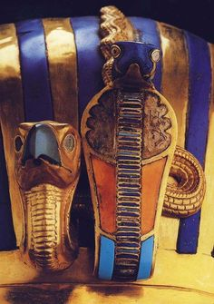Detail in Tut's mummy mask with cobra and vulcher