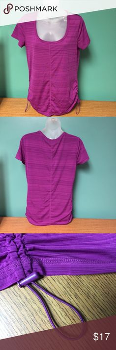 Joe Fresh short sleeve top Size Medium This is a Joe Fresh short sleeve top Size Medium. Color is a magenta/purple color. Size Medium. Ruching at bottom sides with elastic pulls on each side. 84% polyester 16% spandex. Really sweet. Machine washable, tumble dry low. Joe Fresh Tops