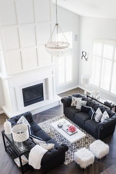 My Formal Living Room   Stoegbauer Home Tour 2016  White Paneled Fireplace with Marble Herringbone Surround   Gray/Brown Herringbone Wood-Look Tile  Dunn Edwards Cloud Paint