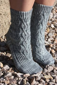 These glamorous cuff-down socks were designed to feature the icy-blue color and subtle sparkle of Ancient Arts Fibre Yarn's Fog Warning colorway. The pattern uses twisted ribbing and lace to create intricate and feminine socks. Lace Patterns, Pdf Sewing Patterns, Knitting Patterns Free, Free Knitting, Crochet Patterns, Crochet Cable, Crochet Socks, Knitting Socks, Knit Socks