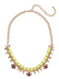 We think this crafty necklace is all kinds of glamorous.  Just check out the neon cord detailing, graphic gold elements and stunning amethyst gems.