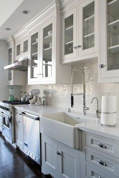 Lovely mix of traditional cabinetry and styling and contempo faucet. LOVE. LOVE. LOVE. #whitekitchens