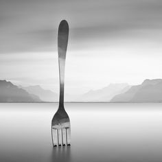 Fork - A photograph of the fork sculpture at Lake Geneva (Lac Leman) in Switzerland. This fork is 50 off the shore of Vevey outside the Alimentarium Food Museum. It is 8 metres high and 1.3 metres wide and made of stainless steel. It was designed by Jean-Pierre Zaugg, a sculptor from Neuchâtel, Switzerland.