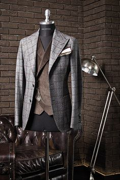 I like the waistcoat. I like the windowpane jacket. I do not like them together. Suit by Tagliatore