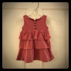 Old Navy Girls Ruffled Tank Old Navy Girls tiered Ruffled Tank. Color is Rise, top of tank is ribbed cotton, bottom is smooth cotton jersey. Size 4T no tears, spots. Be sure to look through the rest of my closet for more cute girls items to bundle with for a great deal.  Old Navy Tops Tank Tops