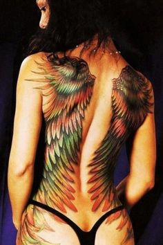 Tattooed Winged Girl with colored feathers body tattoo