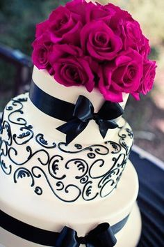wedding cake...with only navy and hot pink roses! I think this is the cake!! :) YAY!!