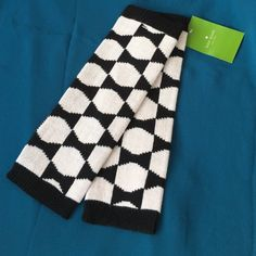 "Kate Spade Arm Warmers NWT! Kate Spade arm warmers in ""signature bow"" print. Colors are black and pastry pink (looks almost white). These arm warmers have thumb holes so they'll keep you warm and won't restrict your fingers! 100% acrylic. kate spade Accessories Gloves & Mittens"