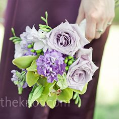 Purple Bridesmaid Bouquet    Danielle chose A-line dresses in a plum hue for her bridesmaids, who walked down the aisle with bouquets of roses, orchids, and green hypericum berries.