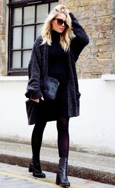 Oversized sweater with fantastic boots.