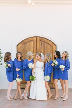 Love these blue long sleeved bridesmaid dresses