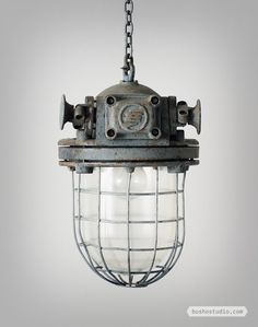 VINTAGE EUROPEAN INDUSTRIAL PENDANT LIGHTS: Lighting is not always light. These industrial pendants decommissioned from a former Czechoslovakian factory for instance are extremely heavy.