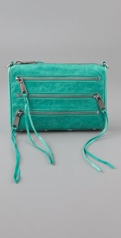 A favorite Sagittarius color to punch up an outfit. (Rebecca Minkoff Mini 5 Zip Clutch - StyleSays)