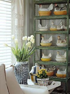 """I don't usually do """"whimsy,"""" but I really love these porcelain hens on nests behind chicken wire in antique coops....thank you atticmag."""