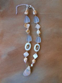 White shell necklace--mother of pearl, natural shell, cut shell beads, seaglass, Swarovski crystals, and pearls with sterling lobster clasp.