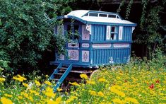 Roald Dahl's Gypsy Caravan.  Blue and pink with white roof. I like the windows up high. Would be nice for loft bedroom ~!~
