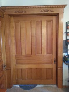 "This huge pocket door is original to the house (built in about 1905).  It is made of solid quarter-sawn white.  It is 7-1/2' tall and just over 5' wide, with a thickness of 1-3/4"".  It runs on a wood track, and has never had any major work done to the structure (though it was refinished about 30 years ago).  The door was originally in place to block off parts of the house to allow for more efficient heating, but now acts as a decorative element and a way to block out sound."