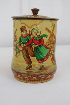 Macfarlane biscuit tin.... Dutch children ice skating.