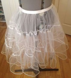 Instructions for knee-length petticoat using 5 yds of tulle. Extra: Bind the hem with ribbon for a fancier/more comfortable finish.