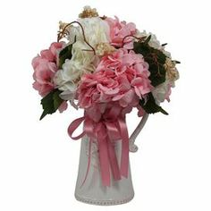"""Enjoy the beauty of nature throughout the seasons with this faux hydrangea arrangement, showcasing budding vine in a white ceramic pitcher.  Product: Faux floral arrangementConstruction Material: Silk and ceramicColor: Pink and whiteDimensions: 14"""" H x 10"""" DiameterCleaning and Care: Wipe gently with a dry cloth. Keep out of direct sunlight."""